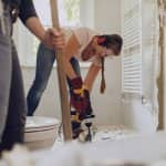 Woman remodeling bathroom (Photo by Guido Mieth / DigitalVision via Getty Images)