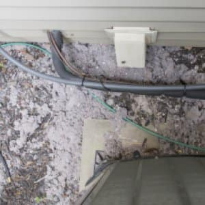 lint accumulating outside a dryer vent opening