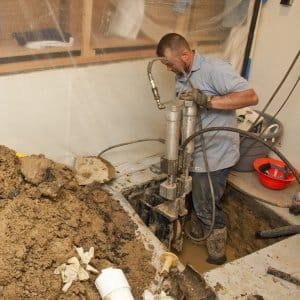 septic worker digging in basement