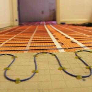 radiant heating coil system installation in bathroom floor