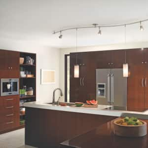 The hanging pendants on this track show off the kitchen island. (Photo courtesy of Tech Lighting)