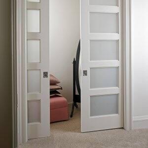 TruStile Doors sliding pocket doors with White Lami glass panels