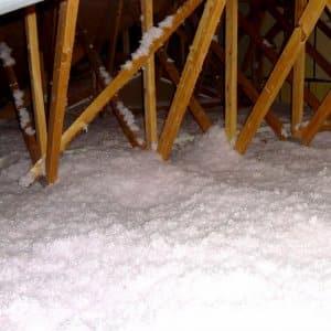white, fluffy cellulose insulation in attic