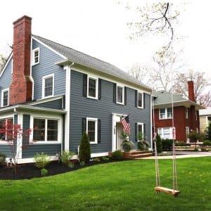 blue house, windows, swing, green grass