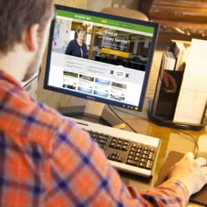 A person on a desktop computer