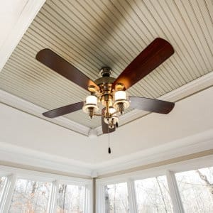 ceiling fan with wood blades and glass globe lights