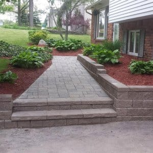 paved walkway to a home