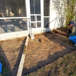 man digging paver patio foundation (Photo by Meranda Adams)