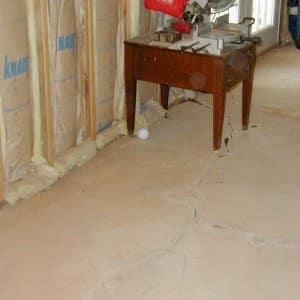 Unfinished basement with cracks