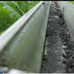 long view of gutter with dirt