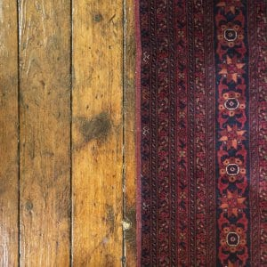 Hardwood flooring with red rug (Photo by Frank Espich)