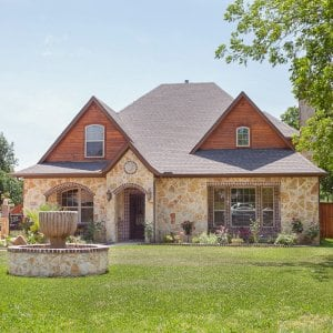 exterior of home with stone and stained wood siding