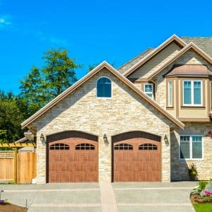 2-story stone house with 2-car garage