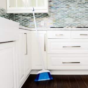 broom leaning against counter in kitchen