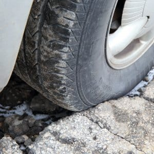 tire in pothole