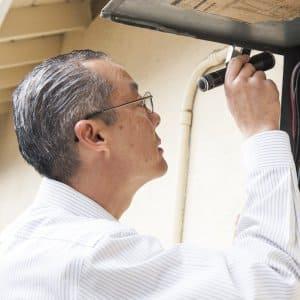 inspector examines electrical circuit breaker panel