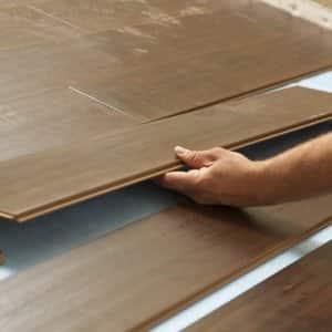 Lifting interlocking laminate flooring planks