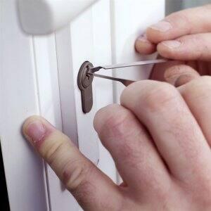 Hands picking a lock
