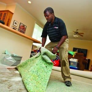 man putting down carpet padding