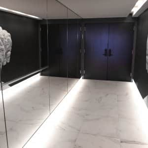 mirror reflecting art in entryway