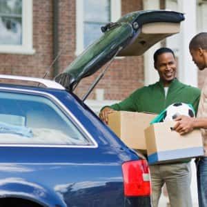 Father and son loading a car for a college move