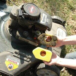 lawn mower side by side clean and dirty air filters