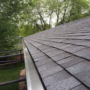 new asphalt shingle roof and gutters with gutter guards