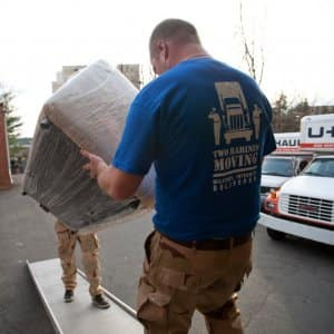 Movers load items into a truck