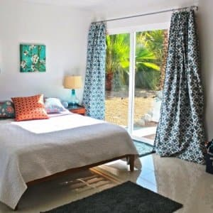 organized bedroom with window view