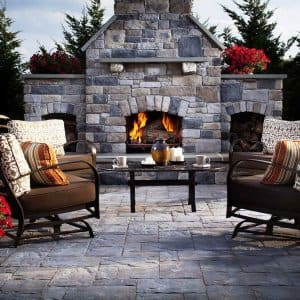 Earth-tone pavers patio and outdoor fireplace