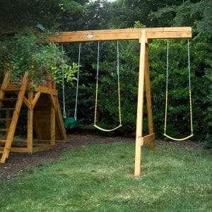 wooden backyard playground set with two swings