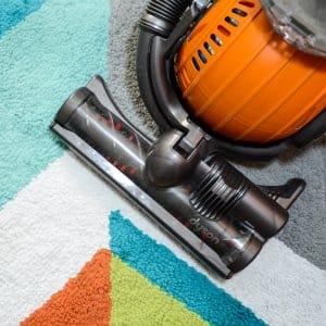 vacuum on colorful rug