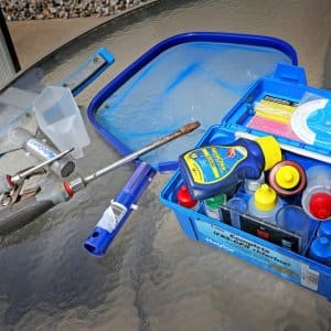 a container filled with swimming pool water testing supplies.