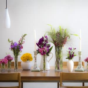 flowers and grasses in glass vases on table (Photo by Frank Espich)
