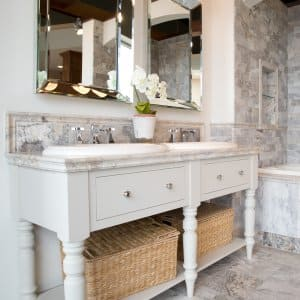 bathroom with double vanity and tile surround tub