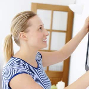 woman handing painting as part of interior design