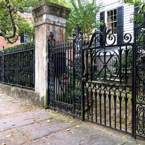 Cast iron fence and gate in front of the Henry Laurens House in Charleston, South Carolina