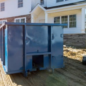 Dumpster outside of new home build (Photo by Ungvar - stock.adobe.com )