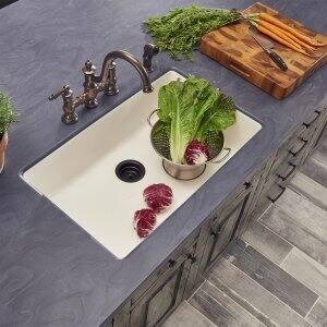 Dark Corian counter around kitchen sink (Photo by Photo courtesy of Dupont)