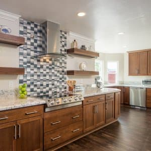 Luxe kitchen remodel upgrade update wood cabinets marble counters tile design