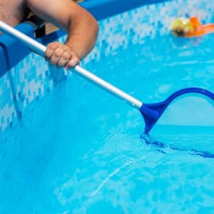 Pool being skimmed (Photo by  Herraez - stock.adobe.com)