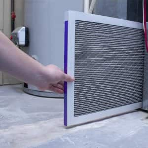 Professional replacing furnace filter (Photo by Oasisamuel - stock.adobe.com)