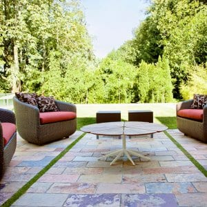 Modern patios with stone pavers and patio seating (Photo by Mint Images/Mint Images RF/Getty Images)