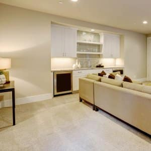 Basement living room with wet bar (Photo by Iriana Shiyan - stock.adobe.com)