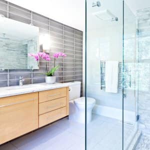 Bright contemporary bathroom with marble tiles (Photo by YinYang/iStock/Getty Images Plus via Getty Images)