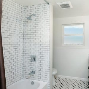 Renovated bathroom with white tile (Photo by coralimages - stock.adobe.com)