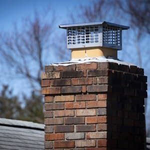 roof with chimney cap  (Photo by Benjamin Clapp - stock.adobe.com)