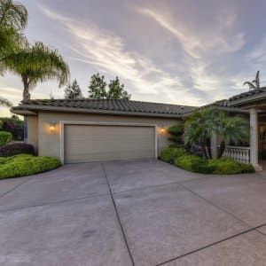 a concrete driveway outside a garage and home during sunset (Photo by © Leo_Visions - stock.adobe.com)