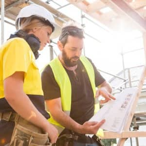 A contractor giving guidance to a worker (Photo by Jessie Casson/DigitalVision via Getty Images)