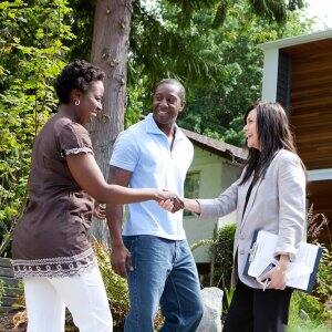 Couple meeting a real estate agent (Photo by Noel Hendrickson via Getty Images)
